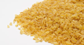Heap of  bulgur wheat groats isolated Royalty Free Stock Photos