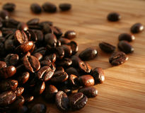 Heap of burnt brown arabica coffee beans Royalty Free Stock Photo