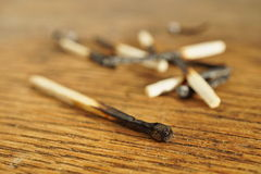 Heap of burnt matches on white background as a symbol of exhaustion, depletion and destruction Stock Photography