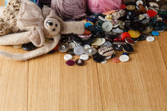 Heap of button on wood table Royalty Free Stock Photography