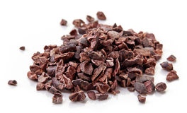 Heap of cacao nibs on white background Stock Image