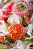 Heap of candies with fruit motifs in cellophane Stock Image