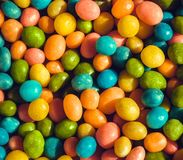 Heap of candy confections small many green, yellow, blue colors. Bright texture and round forms of sweets in sugar Royalty Free Stock Images