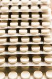 Heap of Capsules packed in blisters, round patterned shaped medicine tablet or antibiotic pills. Medical Pharmacy theme. Close up stock photo