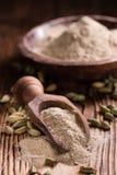 Heap of Cardamon Powder Stock Photo