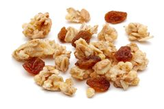 Heap of cereal and raisin on white background. Heap of cereal and raisin isolated on white background stock images