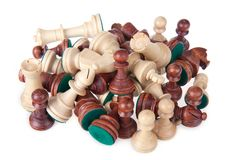 Heap of chess pieces isolated on white Stock Images