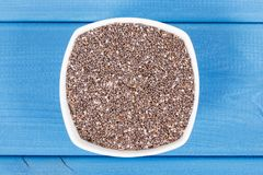 Heap of chia seeds in bowl, concept of food containing natural vitamins, fiber and minerals Stock Photos