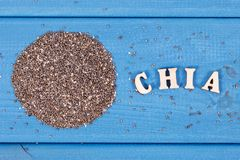 Heap of chia seeds in bowl, concept of food containing natural vitamins, fiber and minerals stock image