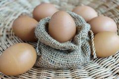 Heap of chicken eggs in sackcloth, easter eggs Stock Photos