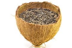 Heap of Chinese green tea in coconut rind.  stock image