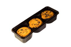 Heap of the chip chocolate cookies in a plastic box. Heap of the chocolate chip cookies in a plastic box isolated on white Stock Images