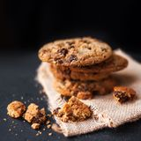 Heap of Chocolate chip cookies on dark background  with place fo Stock Images