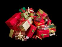 Heap of christmas presents. Beautiful stack of christmas presents with ribbons and bows royalty free stock image