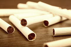 Heap of cigarettes and tobacco Royalty Free Stock Image