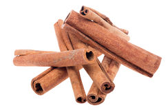 Heap of cinnamon isolated on white Stock Image