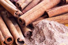 Heap of cinnamon sticks and cinnamon powder Royalty Free Stock Photo