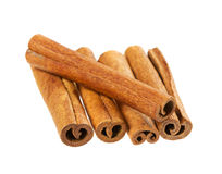 Heap of cinnamon sticks isolated on white background Royalty Free Stock Photo