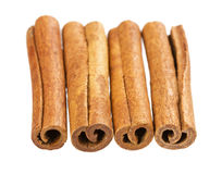 Heap of cinnamon sticks isolated on white background Stock Images