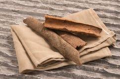 Heap of cinnamon sticks Stock Images