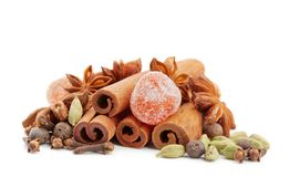Heap of cinnamon sticks, star anise and other spices for christmas mulled wine isolated on white background. Heap of cinnamon sticks, star anise and other stock photography