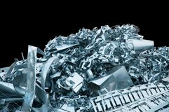 Heap of clean and bright scrap metal on a black background. Pile of clean and shining scrap metal on a black background stock photo