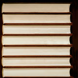 Heap of closed books in hard covers on dark background. Heap of closed books in hard covers on a dark background royalty free stock images