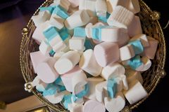 Heap of Closed up Pastel Colored Marshmallows. Colorful marshmallows candy in bowl. White and Blue Marshmallows. stock photography