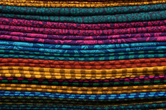 Heap of cloth fabrics at a local market in India. Royalty Free Stock Photo