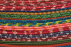 Heap of cloth fabrics at a local market in India. Royalty Free Stock Photos