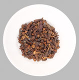 Heap of clove on white plate Royalty Free Stock Images