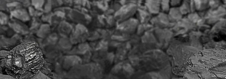 Heap of coal. One rock of coal close up on black coal background. Place for text. Copy space.High quality coal mined in Kuznetzk b Stock Image