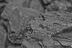Heap of coal. One rock of coal close up on black coal background. Place for text. Copy space.High quality coal mined in Kuznetzk b Royalty Free Stock Photos