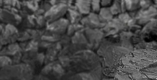Heap of coal. One rock of coal close up on black coal background. Place for text. Copy space.High quality coal mined in Kuznetzk b Royalty Free Stock Photography