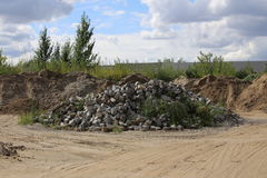 Heap of cobblestones in front of sky royalty free stock photo
