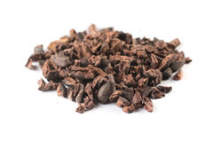 Heap of Cocoa Nibs. Isolated on white background stock images