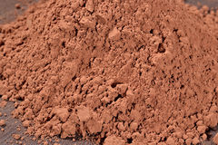Heap of cocoa powder Stock Photos