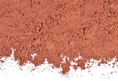 Heap of cocoa powder on a white Royalty Free Stock Photos