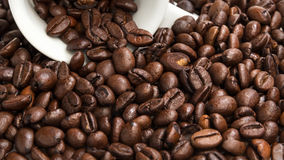 Heap of coffee beans with cup. Coffee background Stock Photos