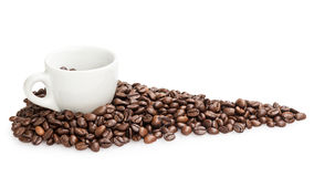Heap of coffee beans with cup. Isolated on white Royalty Free Stock Photography