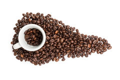 Heap of coffee beans with cup. Isolated on white Royalty Free Stock Image