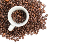 Heap of coffee beans with cup. Isolated on white Royalty Free Stock Photos