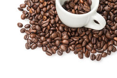 Heap of coffee beans with cup. Isolated on white Stock Photo