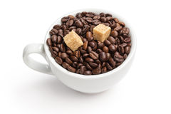 Heap of coffee beans in cup with cane-sugar Stock Images
