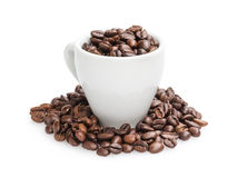 Heap of coffee beans in cup. Isolated on white Royalty Free Stock Image