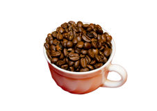 Heap of coffee beans in cup. On a white background Stock Photo