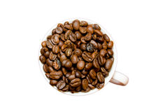 Heap of coffee beans in cup. On a white background Stock Photography