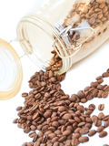 Heap of coffee beans from jar Stock Photography