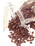 Heap of coffee beans from jar Royalty Free Stock Images