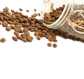 Heap of coffee beans from jar Royalty Free Stock Photography